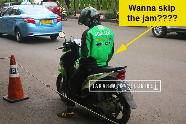 A GoJek driver in Jakarta waiting to pick up a passenger.